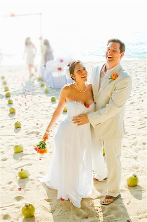 front row seat - Bridal couple laughing on beach Stock Photo - Premium Royalty-Free, Code: 673-06025623