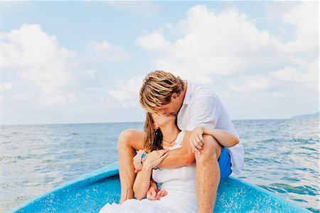 Man and woman embracing in bow of boat Stock Photo - Premium Royalty-Free, Code: 673-06964478