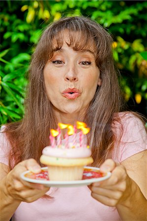 special event - Woman with birthday cupcake Stock Photo - Premium Royalty-Free, Code: 673-06964520