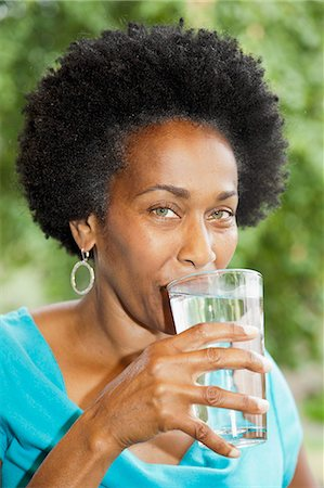 drinking water glass - Woman drinking glass of water Stock Photo - Premium Royalty-Free, Code: 673-06964561
