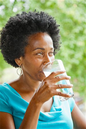 drinking water glass - Woman drinking glass of water Stock Photo - Premium Royalty-Free, Code: 673-06964562