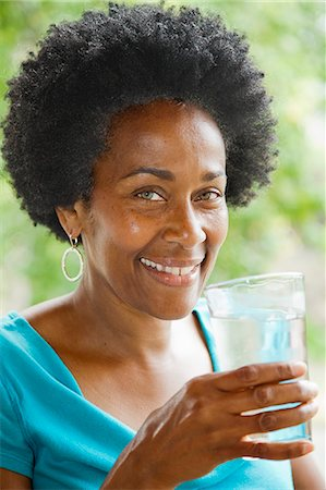 drinking water glass - Woman drinking glass of water Stock Photo - Premium Royalty-Free, Code: 673-06964563