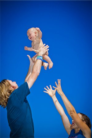 Parents holding baby up in air Stock Photo - Premium Royalty-Free, Code: 673-06964589