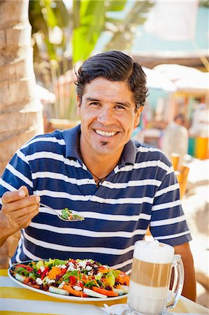 Man eating at outdoor caf Stock Photo - Premium Royalty-Free, Code: 673-06964621