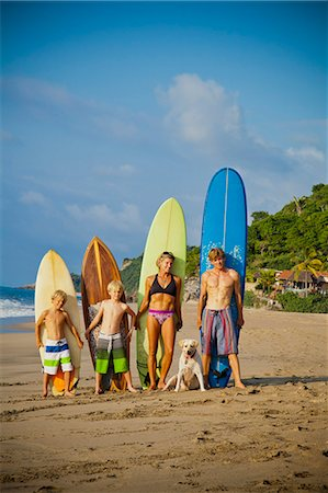 preteen swimsuit - Family standing on beach with surfboards Stock Photo - Premium Royalty-Free, Code: 673-06964632