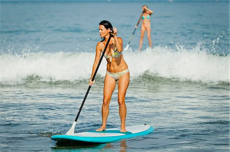 Women on paddle boards Stock Photo - Premium Royalty-Free, Code: 673-06964678