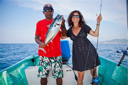 Man and woman on charter fishing boat Stock Photo - Premium Royalty-Free, Code: 673-06964754