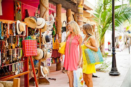 Two women shopping in seaside town Stock Photo - Premium Royalty-Free, Code: 673-06964784