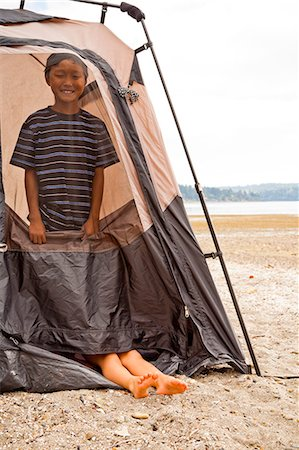 Young children playing in tent on beach Stock Photo - Premium Royalty-Free, Code: 673-06964825