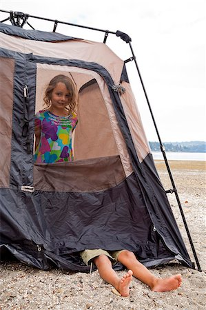 Young children playing in tent on beach Stock Photo - Premium Royalty-Free, Code: 673-06964827