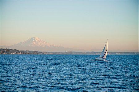 sailboat  ocean - Mt. rainier behind sail boat on puget sound Stock Photo - Premium Royalty-Free, Code: 673-06964834
