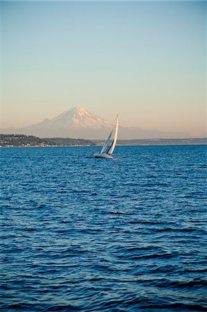 sailboat  ocean - Mt. Rainier behind sail boat on Puget Sound Stock Photo - Premium Royalty-Free, Code: 673-06964835