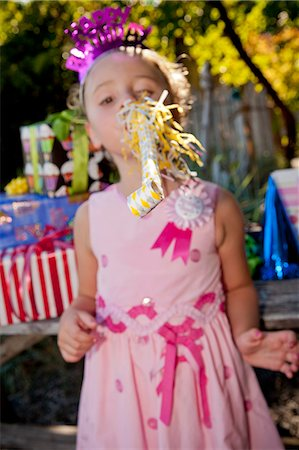 Young girl in birthday party outfit Stock Photo - Premium Royalty-Free, Code: 673-06964858