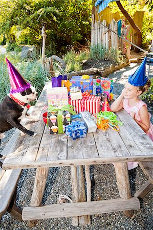 special event - Young girl and dog at outdoor birthday paty Stock Photo - Premium Royalty-Free, Code: 673-06964864