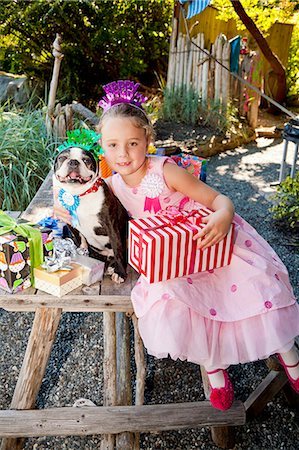 special event - Young girl and dog at outdoor birthday paty Stock Photo - Premium Royalty-Free, Code: 673-06964866