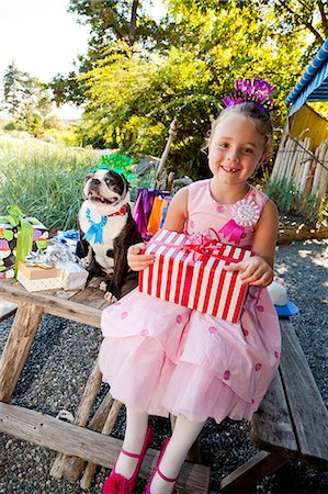 special event - Young girl and dog at outdoor birthday paty Stock Photo - Premium Royalty-Free, Code: 673-06964867