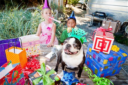 special event - Two children and dog at outdoor birthday party Stock Photo - Premium Royalty-Free, Code: 673-06964861
