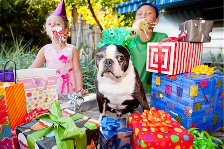 special event - Two children and dog at outdoor birthday party Stock Photo - Premium Royalty-Free, Code: 673-06964862