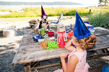 special event - Young girl and dog at outdoor birthday paty Stock Photo - Premium Royalty-Free, Code: 673-06964863