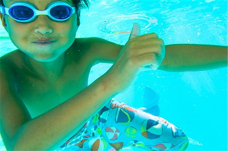 preteen boy shirtless - Underwater view of a boy swimming wearing goggles Stock Photo - Premium Royalty-Free, Code: 673-08139176