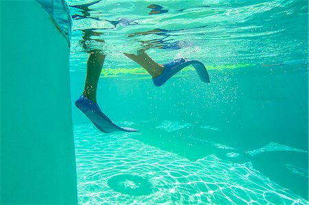 Underwater view of a boy wearing flippers Stock Photo - Premium Royalty-Free, Code: 673-08139178