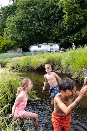 preteen bathing suit - Children playing in a muddy creek Stock Photo - Premium Royalty-Free, Code: 673-08139202