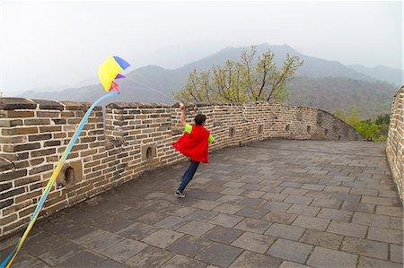 Boy running with a kite on the Great Wall of China, at Mutianyu, Huairou, China Stock Photo - Premium Royalty-Free, Code: 673-08139288