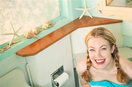 Blonde woman in her bathroom. Stock Photo - Premium Royalty-Free, Code: 673-02137641