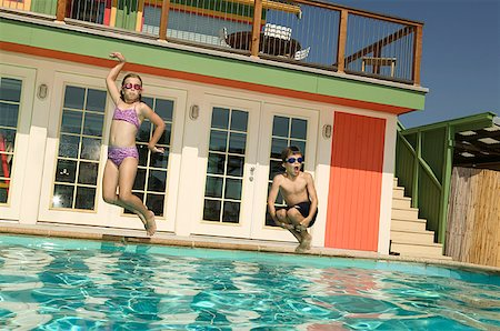 Children jumping into a swimming pool. Stock Photo - Premium Royalty-Free, Code: 673-02137943