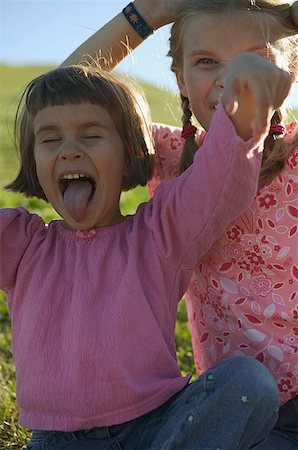 Two young girls making faces. Stock Photo - Premium Royalty-Free, Code: 673-02138111