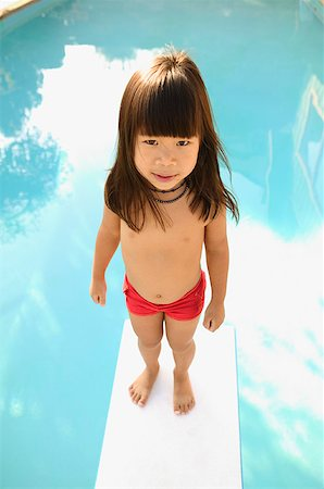 A young girl on a diving board. Stock Photo - Premium Royalty-Free, Code: 673-02138238