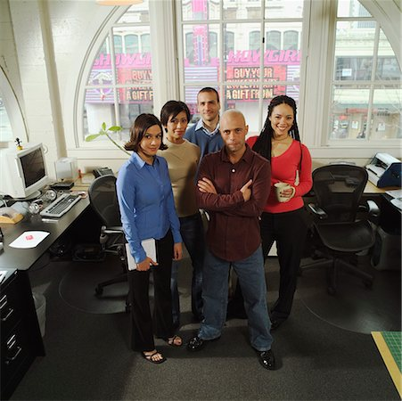 Five young business colleagues in their office. Stock Photo - Premium Royalty-Free, Code: 673-02138380