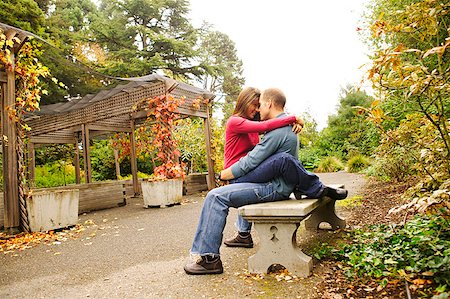 doing sex - A young couple cuddling on a park bench. Stock Photo - Premium Royalty-Free, Code: 673-02138450