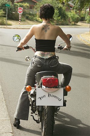 """Woman on motorcycle with a """"Just Divorced"""" sign. Stock Photo - Premium Royalty-Free, Code: 673-02138550"""