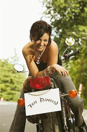 """Woman on motorcycle with a """"Just Divorced"""" sign. Stock Photo - Premium Royalty-Free, Code: 673-02138551"""