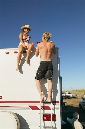Young couple with a recreational vehicle Stock Photo - Premium Royalty-Free, Code: 673-02138665