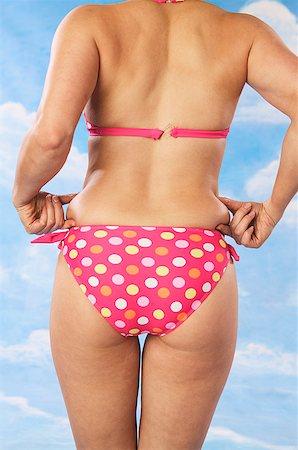 fat woman in bathing suit - Woman wearing pink polka dot bikini Stock Photo - Premium Royalty-Free, Code: 673-02138778