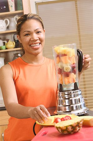 right - Woman making a blended fruit drink Stock Photo - Premium Royalty-Free, Code: 673-02138822