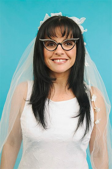 A bride wearing funny glasses Stock Photo - Premium Royalty-Free, Image code: 673-02138968