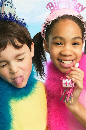 Boy and girl in party hats Stock Photo - Premium Royalty-Free, Code: 673-02139057