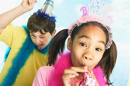 Boy and girl in party hats Stock Photo - Premium Royalty-Free, Code: 673-02139058
