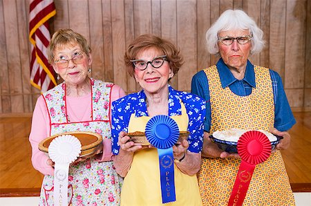 Three women with prizes for homemade pies Stock Photo - Premium Royalty-Free, Code: 673-02139068