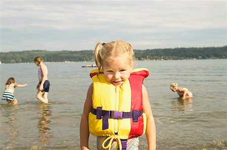 Portrait of little girl at the beach Stock Photo - Premium Royalty-Free, Code: 673-02139123