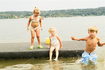 Kids playing on a raft Stock Photo - Premium Royalty-Free, Code: 673-02139162