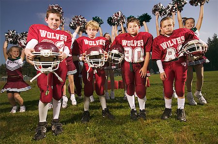 Boys football team and cheerleaders Stock Photo - Premium Royalty-Free, Code: 673-02139178