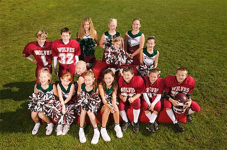 Young football players and cheerleaders Stock Photo - Premium Royalty-Free, Code: 673-02139209
