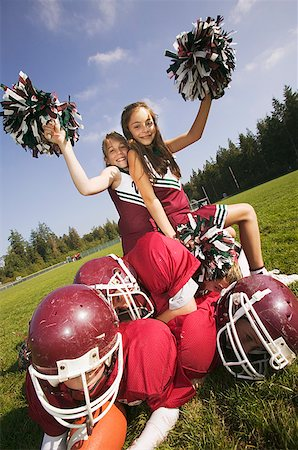 Cheerleaders sitting on football players Stock Photo - Premium Royalty-Free, Code: 673-02139224