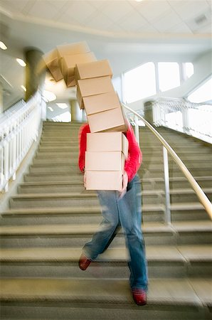 dangerous accident - Woman carrying boxes downstairs Stock Photo - Premium Royalty-Free, Code: 673-02139444