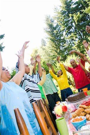 Family singing at summer picnic Stock Photo - Premium Royalty-Free, Code: 673-02139569