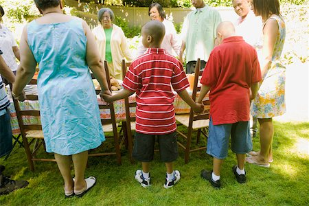 Family holding hands at picnic Stock Photo - Premium Royalty-Free, Code: 673-02139604
